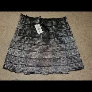 Shiny pleaded skirt
